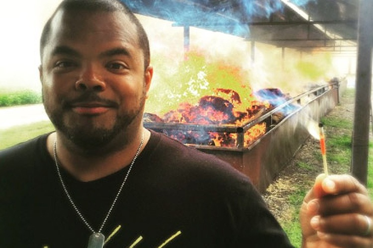 Roger Mooking with a match