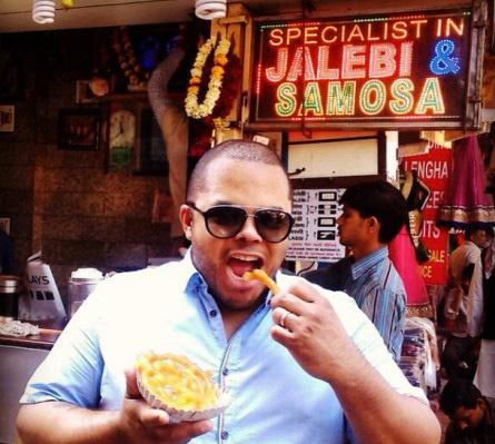Roger in New Delhi eating a local dessert called a Jalebi