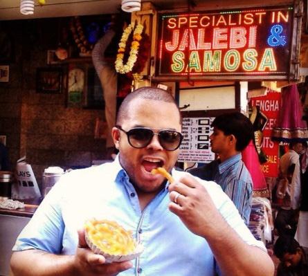 Roger in New Delhi eating a local dessert called a Jalebi